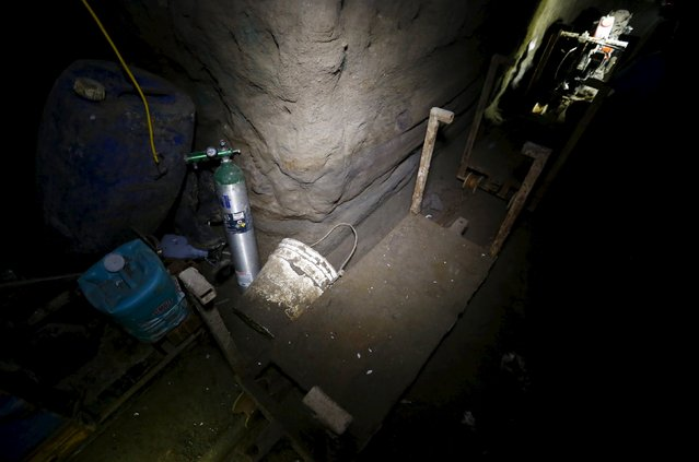 "An oxygen tank stands near a rail cart inside a tunnel connected to the Altiplano Federal Penitentiary and used by drug lord Joaquin ""El Chapo"" Guzman to escape, in Almoloya de Juarez, on the outskirts of Mexico City, July 15, 2015. (Photo by Edgard Garrido/Reuters)"