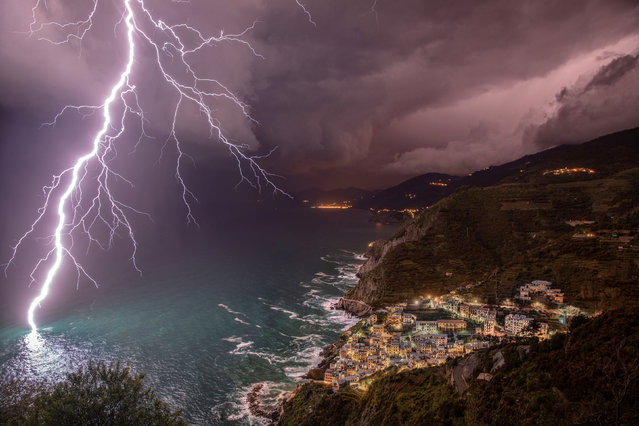 """The Power of Lightning"". Elena Salvai's image of the coast off Riomaggiore, Cinque terre, Italy, was first runner-up and people's favourite. (Photo by Elena Salvai/2019 Weather Photographer of the Year/RMetS)"