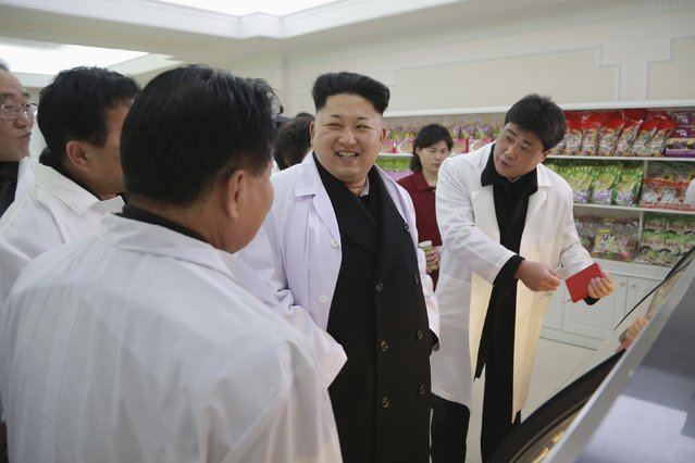 North Korean leader Kim Jong Un (C) provides field guidance at Kumkop General Foodstuff Factory for Sportspersons in this undated photo released by North Korea's Korean Central News Agency (KCNA) in Pyongyang January 18, 2015. (Photo by Reuters/KCNA)