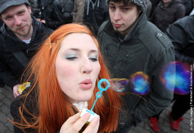 An activist blows bubbles during a demonstration against the Anti-Counterfeiting Trade Agreement (ACTA)