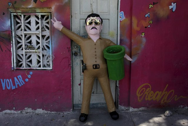 "A  pinata depicting the drug lord Joaquin """"El Chapo"" Guzman at a workshop in Reynosa, July 21, 2015. (Photo by Daniel Becerril/Reuters)"