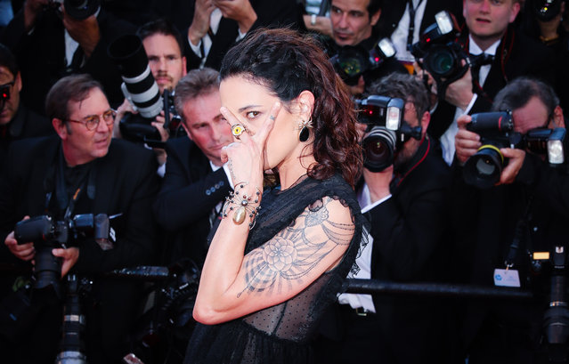 """Asia Argento attends the """"Ismael's Ghosts (Les Fantomes d'Ismael)"""" screening and Opening Gala during the 70th annual Cannes Film Festival at Palais des Festivals on May 17, 2017 in Cannes, France. (Photo by Ki Price/Getty Images)"""