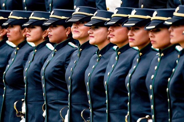 Women members of the national police attend a parade during a graduation ceremony in Bogota, Colombia on November 7, 2019. (Photo by Juan Barreto/AFP Photo)