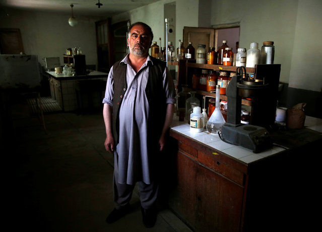 Khuda Daad, head of the laboratory of the Jabal Saraj cement factory, poses for a photograph at his lab in Jabal Saraj, north of Kabul, Afghanistan May 8, 2016. (Photo by Ahmad Masood/Reuters)