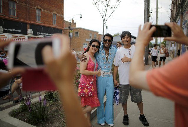 Elvis Presley tribute artist Lorenz Francke of Scarborough, Ontario poses with fans during the four-day Collingwood Elvis Festival in Collingwood, Ontario July 25, 2015. (Photo by Chris Helgren/Reuters)