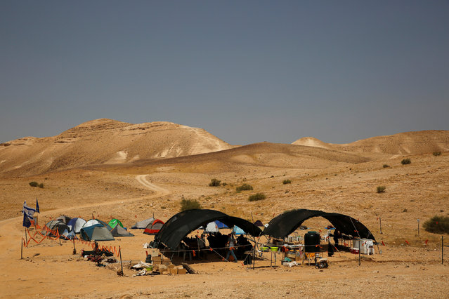 An Israeli Antique Authority camp is seen near the Cave of the Skulls, an excavation site in the Judean Desert near the Dead Sea, Israel June 1, 2016. (Photo by Ronen Zvulun/Reuters)