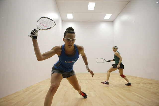 Mexico's Samantha Salas, right, competes with Michelle Key of the U.S. as part of the women's racquetball team event at the Pan Am Games in Toronto, Sunday, July 26, 2015. Mexico defeated the U.S. to win gold in both men's and women's team racquetball events. (Photo by Rebecca Blackwell/AP Photo)