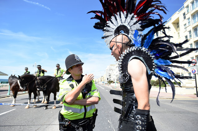 A police officer advises festival goer of the new route that has been set for the parade following a bomb scare during Brighton Pride 2015 on August 1, 2015 in Brighton, England. (Photo by Tabatha Fireman/Getty Images)