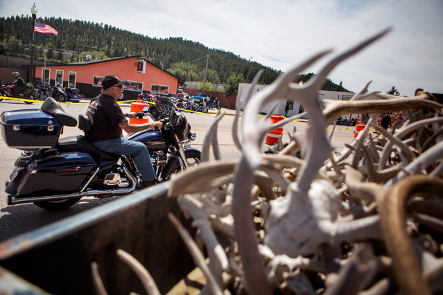 Bikers cruise along Main Street in downtown Custer while participating in the annual Sturgis Motorcycle Rally in South Dakota on August 3, 2015. (Photo by Kristina Barker/Reuters)