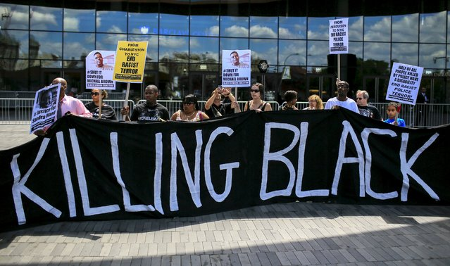 Protesters take part in a rally at Barclays Center marking the first anniversary of the death of Michael Brown, in Brooklyn, New York August 9, 2015. (Photo by Eduardo Munoz/Reuters)