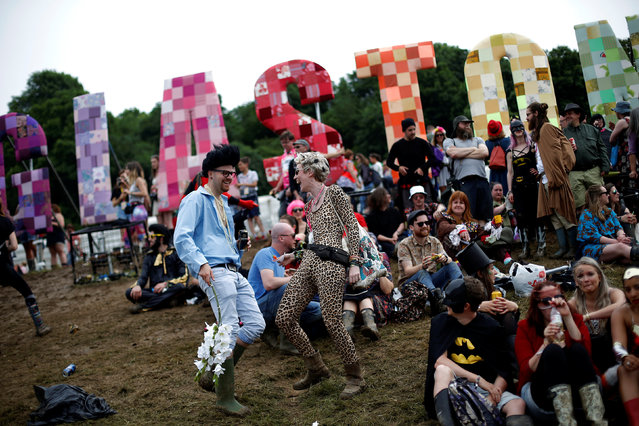Revellers take part in the Vloody Cloody Heroes Parade during the Glastonbury Festival at Worthy Farm in Somerset, Britain, June 23, 2016. (Photo by Stoyan Nenov/Reuters)