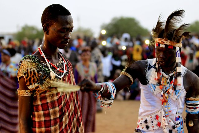 A spiritual healer from the Nuba Mountains tribe performs during a celebration of their cultural heritage, as part of ongoing events to commemorate the International Day of the World's Indigenous Peoples, in Omdurman August 15, 2015. (Photo by Mohamed Nureldin Abdallah/Reuters)