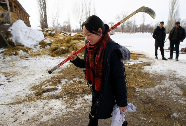 A member of Kyrgyzstan's first female hockey team arrives for a training session in the village of Otradnoye, Kyrgyzstan on February 4, 2020. Based in the remote village of Otradnoe, 249 miles (400 kilometres) east of the country's capital Bishkek, the team comprises of around 15 girls from a local school and uses a flooded allotment to train on during the winter months. (Photo by Vladimir Pirogov/Reuters)