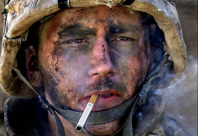 Marine Lance Cpl. James Blake Miller, 20, of Kentucky, a member of Charlie Company of the U.S. Marines First Division, Eighth regiment, smokes a cigarette in Fallujah, Iraq