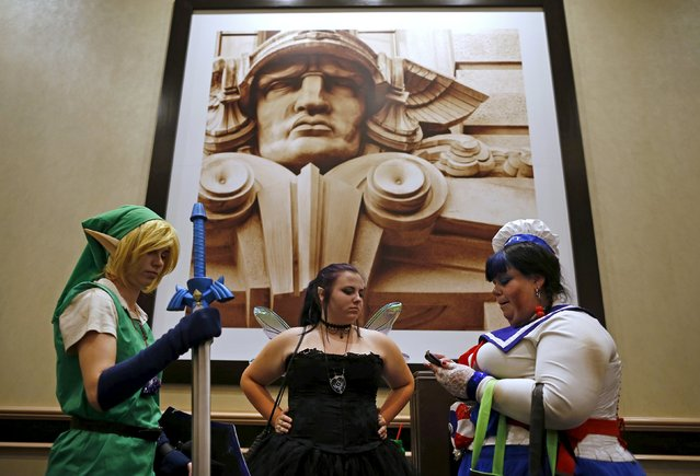 Contestants wait in the hallway for their chance to compete in the costume contest at Wizard World Comic Con in Chicago, Illinois, United States, August 22, 2015. (Photo by Jim Young/Reuters)