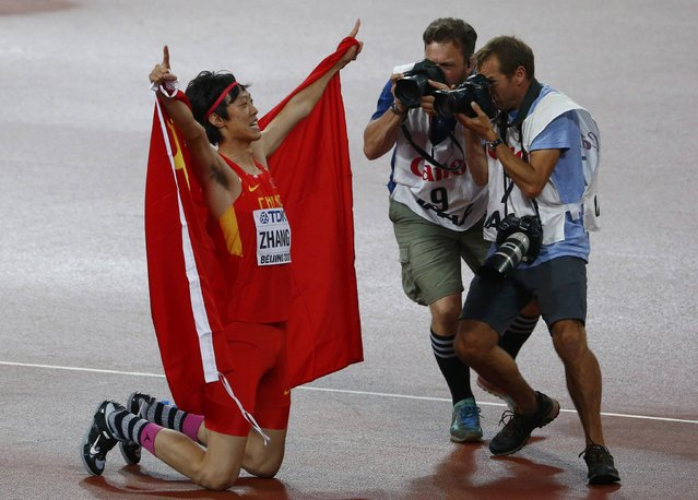 Guowei Zhang of China celebrates after winning joint silver in the men's high jump final during the 15th IAAF World Championships at the National Stadium in Beijing, China August 30, 2015. (Photo by David Gray/Reuters)