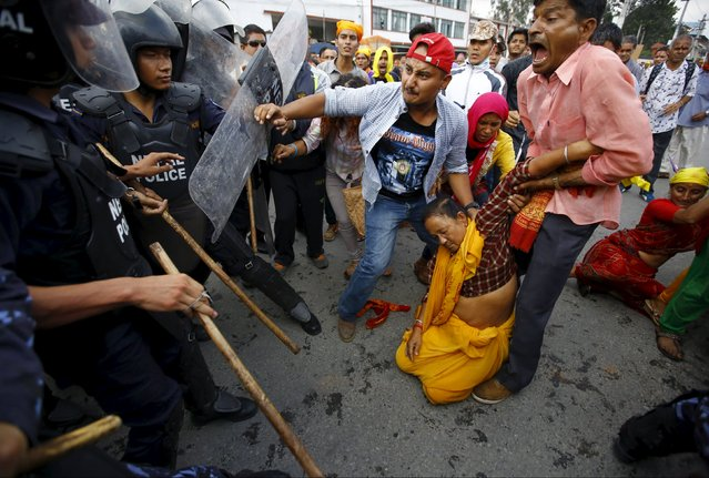 A Hindu activist faints after falling down during a clash with police during a protest rally in Kathmandu, Nepal September 1, 2015. The protesters tried to break through a restricted area near the parliament as they demanded Nepal be declared a Hindu State in the new constitution. (Photo by Navesh Chitrakar/Reuters)