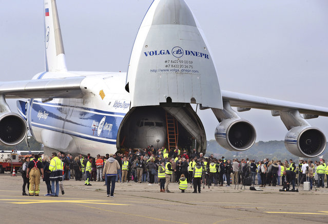 """A Russian Antonov transport plane AN124 carries parts  of Lufthansa plane """"Landshut"""" as it stands at the airport in Friedrichshafen, Germany, Saturday, September 23, 2017. The  Lufthansa passenger jet hijacked to Somalia 40 years ago at the height of the leftist Red Army Faction's campaign against West German authorities has returned home. The dpa news agency reported Saturday most parts of the Boeing 737 arrived Saturday in the southern city of Friedrichshafen, where they will be reassembled and displayed at the Dornier Museum.  (Photo by Karl-Josef Hildenbrand/DPA via AP Photo)"""