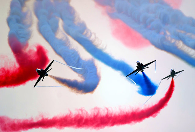 """The British Royal Air Force's (RAF) aerobatic team, the """"Red Arrows"""", performs aerial manoeuvres during celebrations marking Saudi Arabia's 87th National Day, in Jeddah on September 25, 2017. (Photo by Amer Hilabi/AFP Photo)"""