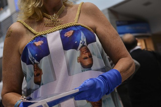 """A delegate wears a Barack Obama dress and a """"President Hillary"""" necklace during the Democratic National Convention in Philadelphia, Pennsylvania. U.S. July 27, 2016. (Photo by Charles Mostoller/Reuters)"""