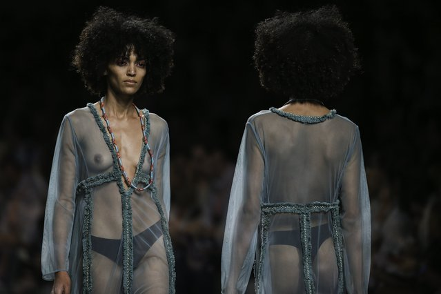 A multi-exposure photo of a model displaying a creation by French designer Christophe Sauvat during his runway show at Lisbon Fashion Week, at Carlos Lopes Pavillion in Lisbon, Portugal, 07 October 2017. (Photo by Miguel A. Lopes/EPA/EFE)