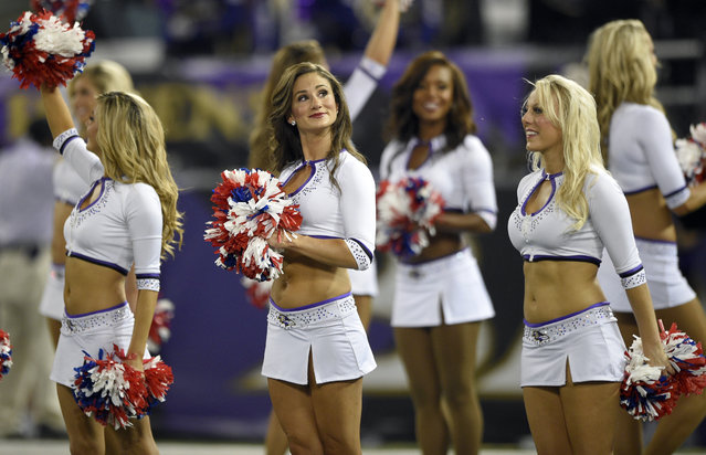 The Baltimore Ravens cheerleaders pause during the first half of an NFL football game against the Pittsburgh Steelers Thursday, September 11, 2014, in Baltimore. (Photo by Nick Wass/AP Photo)