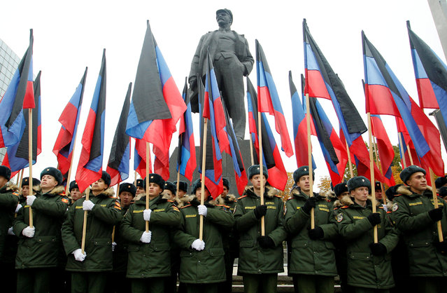 Students of a military school stand in formation in front of a monument to Soviet state founder Vladimir Lenin before the march marking the Day of Flag of the self-proclaimed Donetsk People's Republic (DNR) in the rebel-controlled city of Donetsk, Ukraine October 25, 2017. (Photo by Alexander Ermochenko/Reuters)
