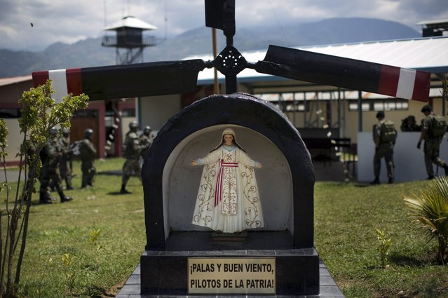 "In this September 19, 2014 photo, The image of the Virgin of the military pilots is seen at the Mazamari counternarcotics military base in the Apurimac, Ene and Mantaro River Valleys, or VRAEM, the world's No. 1 coca-growing region, in Junin, Peru. The inscription below the image reads in Spanish ""Blades and good wind, Pilots of the Fatherland"". (Photo by Rodrigo Abd/AP Photo)"