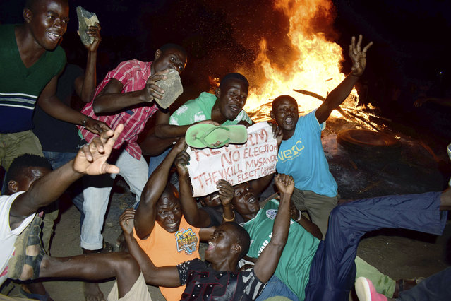 Residents demonstrate as they burn tires in the street  after the election result was announced, in Kisumu, Kenya, Monday, October 30, 2017. Clashes erupted after Kenya's election commission said President Uhuru Kenyatta had won the election that was boycotted by the main opposition group. (Photo by AP Photo/Stringer)