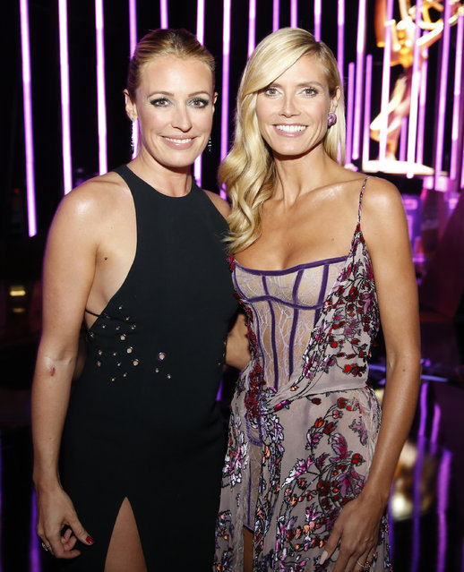 Cat Deely, left, and Heidi Klum pose backstage at the Television Academy's Creative Arts Emmy Awards at Microsoft Theater on Saturday, September 12, 2015, in Los Angeles. (Photo by Colin Young-Wolff/Invision for the Television Academy/AP Images)