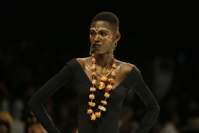 A model displays creations by Maybelline during the Fashion and Design Week in Lagos, Nigeria, Friday, October 27, 2017. (Photo by Sunday Alamba/AP Photo)