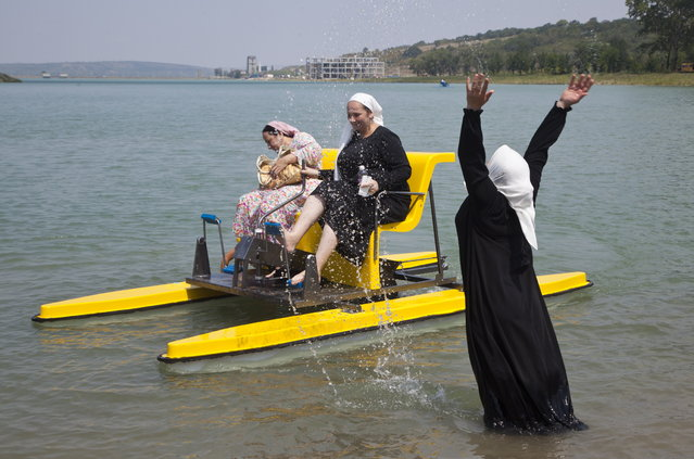 Vacationers at the Laguna (Lagoon) women's resort in the village of Aldy on the Grozny Sea shore in Chechnya, Russia on August 4, 2015. (Photo by Yelena Afonina/TASS)