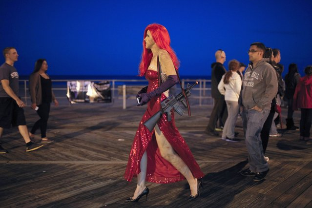 A reveller takes part in a Zombie Walk in Asbury Park, New Jersey October 4, 2014. (Photo by Eduardo Munoz/Reuters)