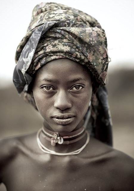 """Mucubal tribe beauty – Angola. A Mucabal girl without the giant headwear! Mucubal (also called Mucubai, Mucabale, Mugubale) people are a subgroup of the Herero ethnic group, which means they are bantu speaking, and are supposed to have come from Kenya and to be related with Massais"". (Eric Lafforgue)"