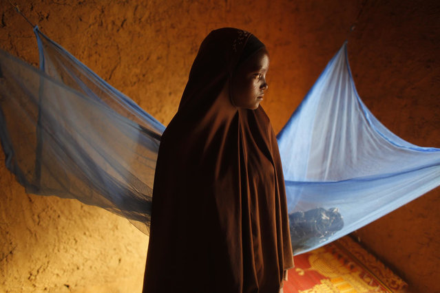 In this Wednesday, July 18, 2012, file photo, Zali Idy, 12, poses in her bedroom in the remote village of Hawkantaki, Niger. Zali was married in 2011. Child marriage affects nearly 15 million girls around the world, and West and Central Africa has six of the 10 countries with the highest rate. (Photo by Jerome Delay/AP Photo)