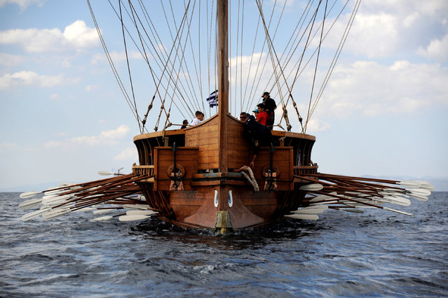"""Citizens have the chance to row """"Olympias"""", a reconstruction of an ancient Athenian trireme, a ship commissioned in the Greek Navy, in the southern suburb of Faliro in Athens, Greece, August 28, 2016. (Photo by Michalis Karagiannis/Reuters)"""