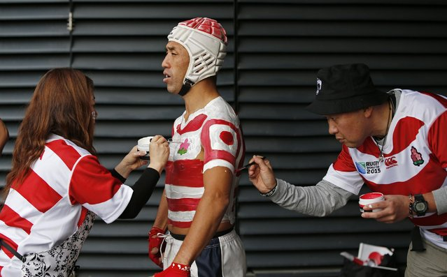 Rugby Union, Samoa vs Japan, IRB Rugby World Cup 2015 Pool B, Stadium MK, Milton Keynes, England on October 3, 2015: Japan fan has his body painted before the game. (Photo by Andrew Boyers/Reuters/Action Images)