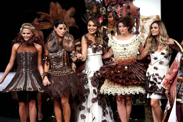(L-R) Kelly Vedovelli, Ludivine Sagna, Valerie Begue, Rachel Legrain-Trapani and Clara Morgane walk the runway and wears a chocolate costume made by designer and a chocolate maker during the Fashion Chocolate show at Salon du Chocolat at Parc des Expositions Porte de Versailles in Paris, France, October 28, 2014. (Photo by LAURENTVU/SIPA Press)