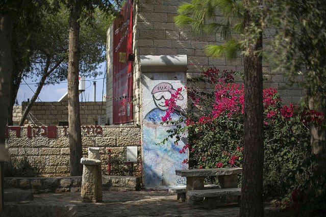 A piece of the Berlin Wall is seen in the artists' village of Ein Hod near Haifa in Israel October 17, 2014. (Photo by Baz Ratner/Reuters)