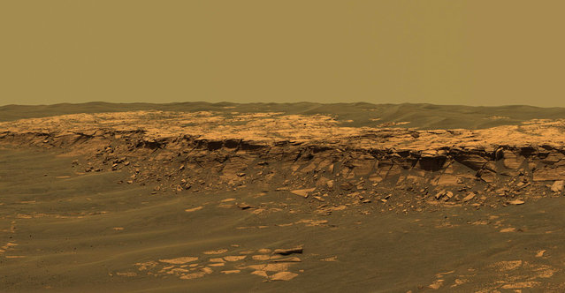 "The panoramic camera aboard Opportunity acquired this panorama of the ""Payson"" outcrop on the western edge of Erebus Crater during Opportunity's sol 744 (February 26, 2006). From this vicinity at the northern end of the outcrop, layered rocks are observed in the crater wall, which is about 1 meters (3.3 feet) thick. The view also shows rocks disrupted by the crater-forming impact event and subjected to erosion over time. (Photo by NASA/JPL-Caltech/USGS/Cornell University/The Atlantic)"