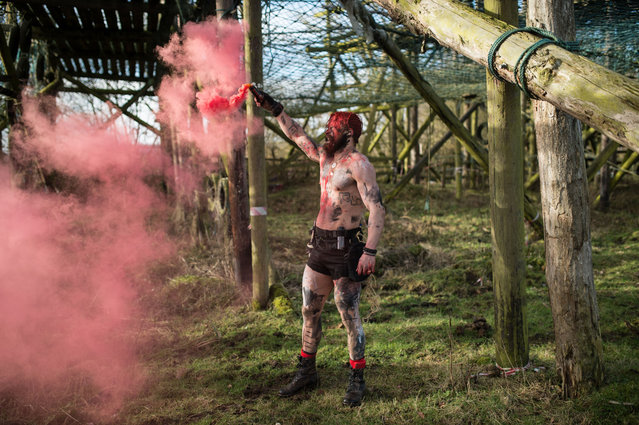 Tough Guy staff encourage and motivate competitors participating in the Tough Guy endurance event near Wolverhampton, central England, on February 4, 2018. (Photo by Oli Scarff/AFP Photo)