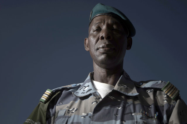 Malian chief of Gao's gendarmerie district, Colonel Salhiou Maiga poses in the office of the Gao's gendarmerie in Gao, on February 24, 2013. After recapturing the north's cities from the Al Qaeda groups that had controlled them since April 2012, the six-week-long French-led offensive took the fight to the retreating Islamist insurgents' toughest desert bastions. (Photo by Joel Saget/AFP Photo/The Atlantic)