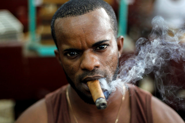 Yosvani Herrera (36)  looks on while working at the H. Upmann cigar factory during the XX Habanos Festival in Havana, Cuba, March 1, 2018. (Photo by Reuters/Stringer)