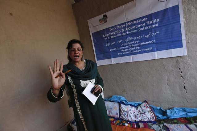 Beena Hussain, a trainer, gestures while speaking to women cotton pickers during a leadership and advocacy skills workshop organised by the Sindh Community Foundation (SCF), in Meeran Pur village, north of Karachi November 23, 2014. (Photo by Akhtar Soomro/Reuters)