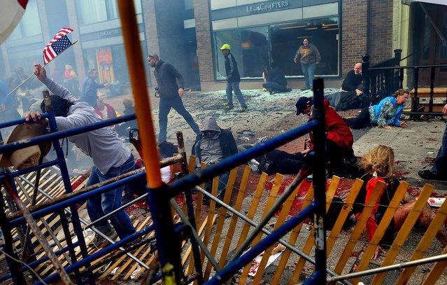 The scene moments after an explosion near the finish line of the Boston Marathon. (Photo by John Tlumacki/The Boston Globe)