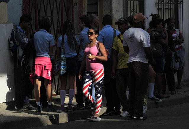 A woman wearing pants with the colors of the U.S. flag walks on a street in Havana December 17, 2014. (Photo by Reuters/Stringer)