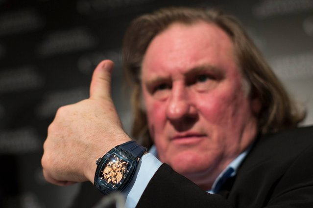 "Actor Gerard Depardieu looks on during a presentation of watches by CVSTOS, a Swiss luxury watch brand from the line ""Proud to be Russian"" in Moscow, Russia, Wednesday, December 17, 2014. (Photo by Alexander Zemlianichenko/AP Photo)"