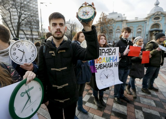 "Gay rights activists attend a rally outside the parliament building in Kiev, Ukraine, November 12, 2015.  The banner reads: ""Human rights always"". (Photo by Gleb Garanich/Reuters)"