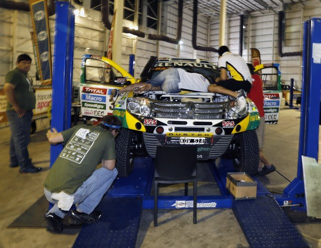 Mechanics work in the Renault car belong to Argentina's Emilio Spataro and Benjamin Lozada during technical verification ahead of the Dakar Rally 2015 in Buenos Aires January 1, 2015. (Photo by Enrique Marcarian/Reuters)