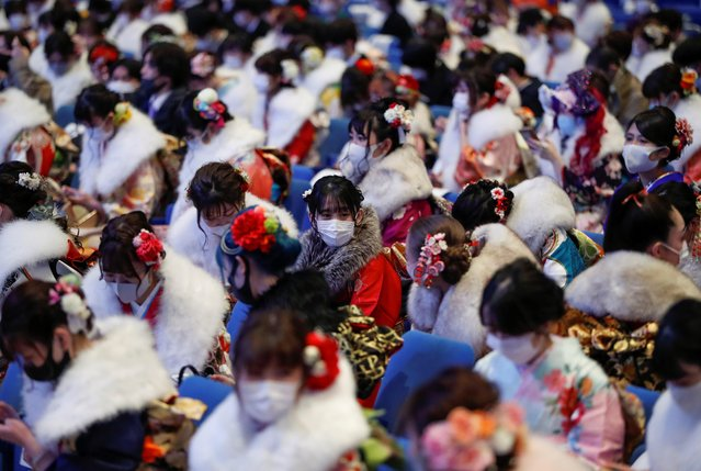 Youths including kimono-clad women wearing protective face masks attend their Coming of Age Day celebration ceremony at Yokohama Arena during the government declared the second state of emergency for the capital and some prefectures, amid the coronavirus disease (COVID-19) outbreak, in Yokohama, south of Tokyo, Japan on January 11, 2021. (Photo by Issei Kato/Reuters)